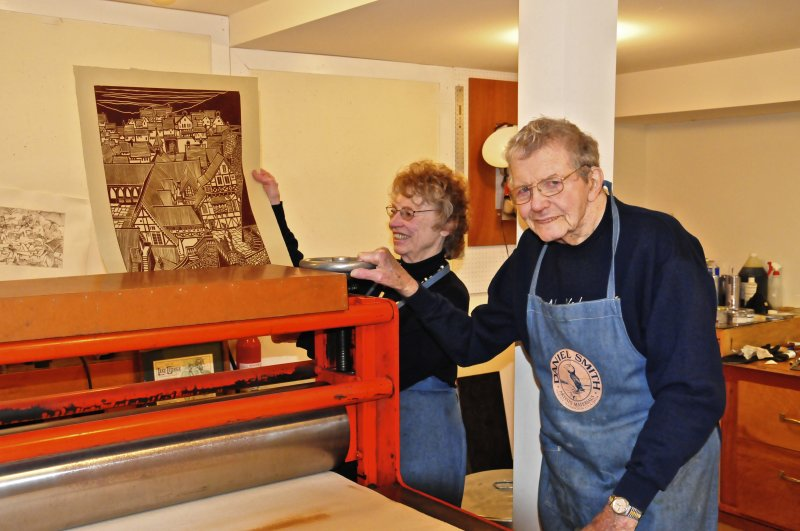 Fred and Mary at the etching press with a block print