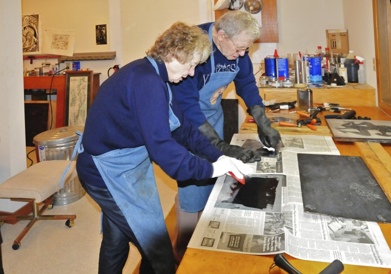 Fred and Mary inking etching plates before printing